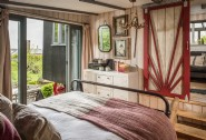 The airy Bohemian master bedroom in luxury self-catering accommodation