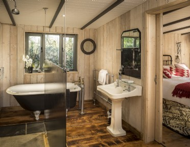 Vintage bathroom with claw-foot bath and double shower, Cornwall