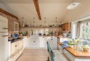 The classic country kitchen is complete with a traditional Aga