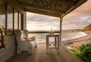Enjoy sunsets from the veranda of The Beach Hut
