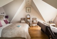The spacious master bedroom sits under the ´eyebrow´ of the eaves