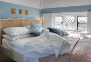 A charming master bedroom with French-style king-size bed
