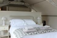 The master king-size en suite bedroom nestles beneath charming eaves