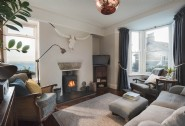 Curl up beside the log burner and enjoy mesmerising sea views
