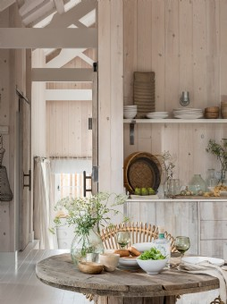 Dinning area with exposed wood, thick linens