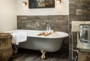 The family bathroom features a vintage clawfoot bath and walk-in rain shower