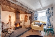 Snuggle up by the huge inglenook fire in the living room