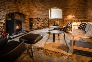 The central floor makes a cosy snug area, complete with log fire and seating
