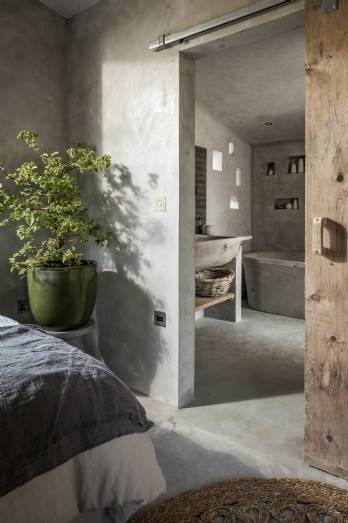 En suite with double sink, cast concrete bath and rain shower