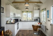 Light filled well equipped kitchen joins the open plan dining and living area