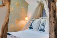 The double bedroom is an elegant boudoir