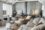 The light filled sitting room with harbour views and a roaring log burner