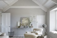 Chalky whites and muted hues make the living area a peaceful space