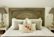 Vintage queen-size bedroom with hand-carved oak headboard