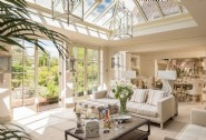 The orangery spruced with indoor palms and hanging hurricane lanterns