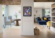 The open plan design showcases a stunning walk-through art collection
