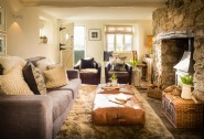 Curl up in the cosy lounge with log fire