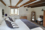 Large double bedroom benefits from dual aspect windows