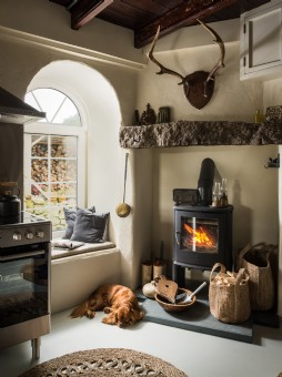 Engine house kitchen with window seats and log burner
