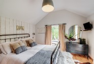 The master bedroom at The Wool Shed, near Watergate Bay