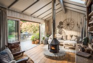 Textured rugs and soft linens bring warmth and nature into this luxury home