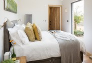 The cosy double bedroom includes a king-size bed and French windows