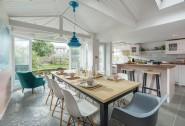 The light-filled kitchen has French doors leading to the garden