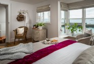 The master bedroom with en suite bathroom and sea views