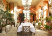 The beguiling orangery bursting with botanics can seat up to 40 guests