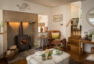 Cosy up by the log burner at this perfect romantic retreat