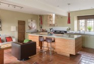 The contemporary kitchen complete with traditional Aga cooker