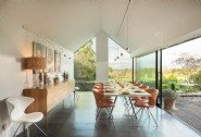 The glass dining room opens onto the terrace at the back of the house