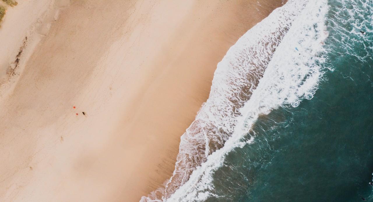 Drone Image of Blue Shore Line | Coastal Retreats